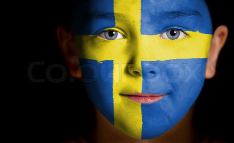 Portrait of a child with a painted swedish flag