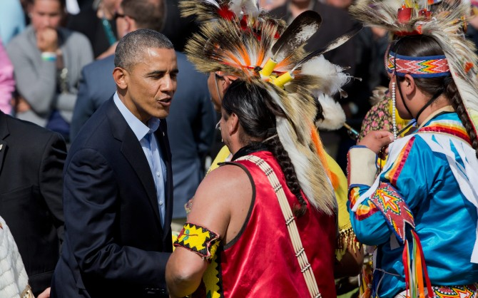 President Barack Obama greets the members of the Standing Rock Sioux Tribal Nation, in Cannon Ball, N.D., Friday, June 13, 2014, during a Cannon Ball flag day celebration, at the Cannon Ball powwow grounds. It's the president's first trip to Indian Country as president and only the third such visit by a sitting president in almost 80 years. (AP Photo/Manuel Balce Ceneta)