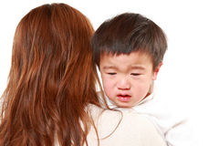 crying-japanese-little-boy-who-being-held-her-mother-79834763